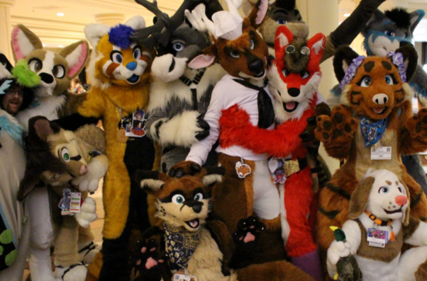 A group photo of people dressed up as furry animals. (Photo: Fur the More