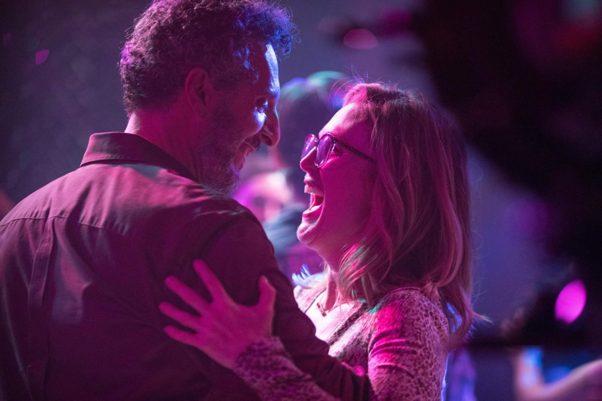"""John turturro and Julianne Moore dancing in a club in """"Gloria Bell."""" (Photo: A24)"""