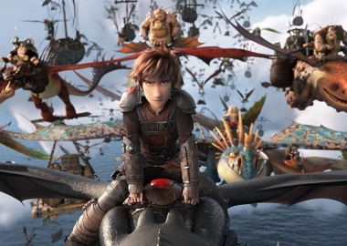 Hiccup flys Toothless into battle with the rest of his vikings fly behind. (Photo: Universal PIctures)