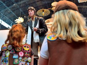 A woman portraying Amelia Earhart talks to brownie scouts. (Photo: Udvar-Hazy Center)