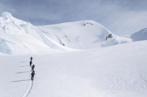 Four people walking through the snow up Mount Kennedy. (Photo: Environmental Film Festival)