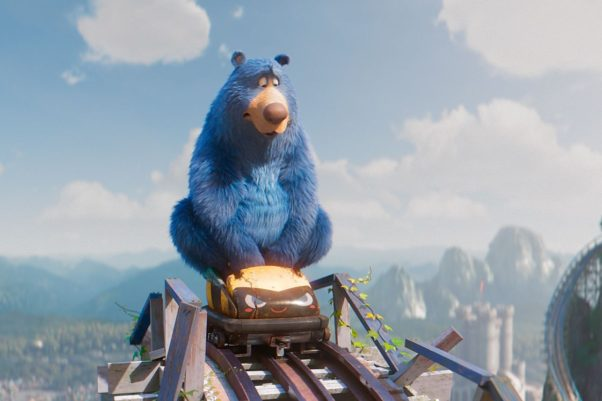 Boomer the blue bear riding a roller coaster in a scene from Wonder Park. (Photo: Paramount Animation)