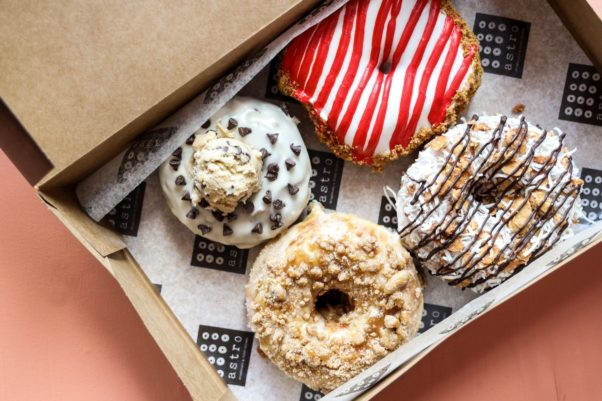 """Astro Doughnuts' March flavors include (clockwise from top) cherry cheesecake, coconut almond """"Almond Joy,"""" bananas foster and chocolate chip cookie dough. (Photo: Jennifer Chase)"""