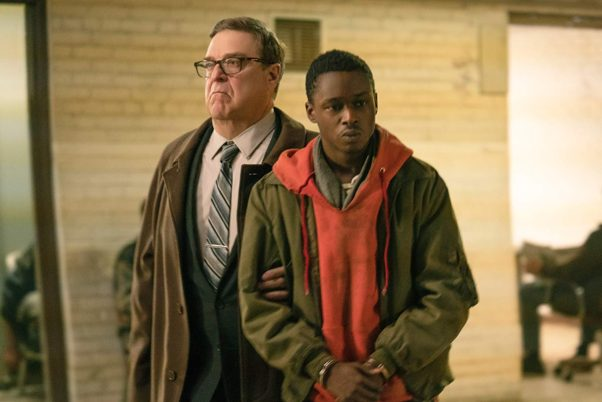 William Mulligan (John Goodman) leads Gabriel Drummond (Ashton Sanders) away in handcuffs. (Photo: Storyteller Distribution Co.)