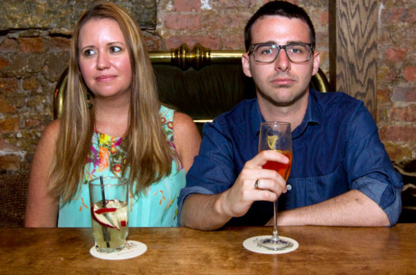A very bored looking man and woman having drinks. (Photo: New York Post)