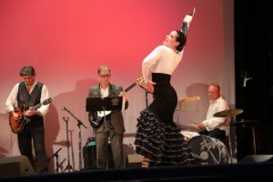 A flaminko dances in front of a band. (Photo: Atlast Performing Arts Center)