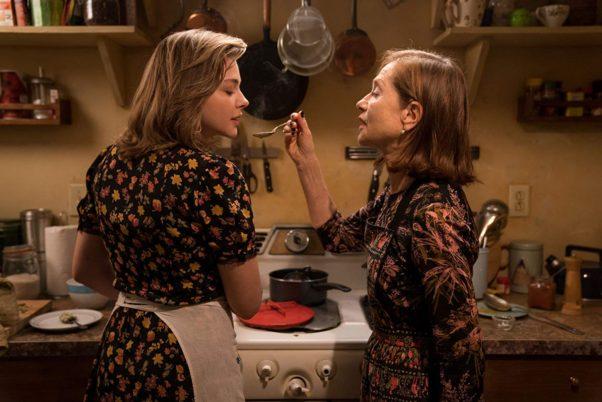 Frances Mccullen (Chloë Grace Moretz) and Greta Hedeg (Isabelle Huppert) cook together in the kitchen. (Photo: Focus Films)