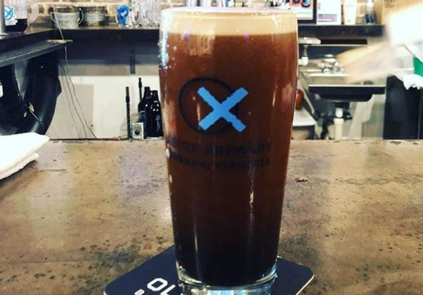 A glass of Old Ox Black Ox Nitro in a glass with the brewery's logo on it sitting on a bar at the brewery. (Photo: Old Ox Brewery)