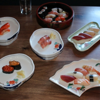 several different kinds of sushi displayed on plates on a table. (Photo: Mark Heckathorn/DC on Heels)