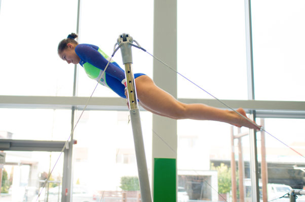A gymnast performs on the high bar. (Photo: Getty Images)
