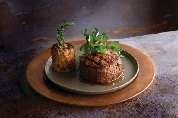 Morton's all-natural 10-ounce filet on a metal plate with a bone filled with bone marrow beside it. (Photo: Morton's)