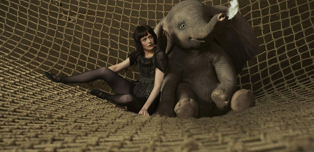 Collette (Eva Green) sitting with a baby Dumbo in a trapeeze net. (Photo: Walt Disney Studios)