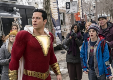 Shazam (Zachary Levi) and Freddy Freman (Jack Dylan Grazer) look at something happening out of picture. (Photo: Warner Bros. Pictures)