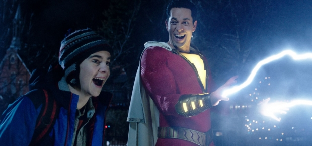 Freddy Freman (Jack Dylan Grazer) and Shazam (Zachary Levi) laugh as lightning shoots out of Shazam's hands. (Photo: Warner Bros. Pictures)