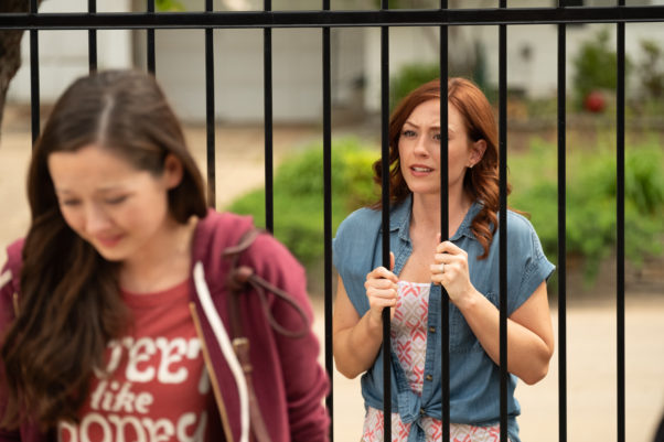 Abby Johnson (Ashley Bratcher) talks to a woman going to get an abortion through a fence. (Photo: Soli Deo Gloria Releasing)