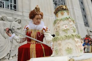 Queen Elizabeth cuts Shakespeare's birthday cake with a sword. (Photo: Lloyd Wolf)
