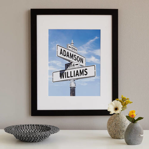 """Street sign with one saying """"Adamson"""" above one saying """"Williams."""" (Photo: Uncommon Goods)"""