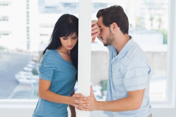 Man and woman on opposite sides of a wall with heads against wall. (Photo: 123rf)