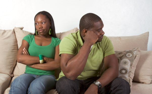 Young black ethnic African-American couple at odds and bad mood not talking with each other and looking away after heated argument. (Photo: Shutterstock)