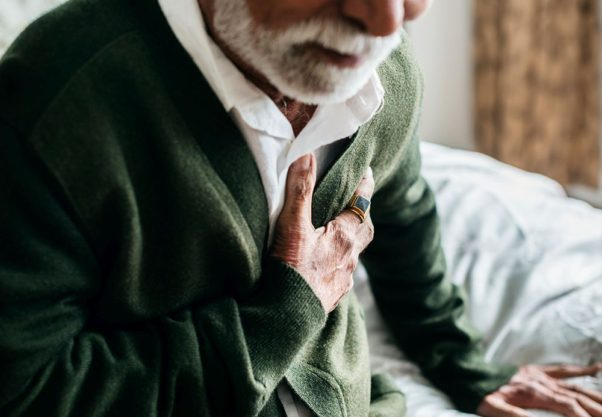 An older man with a white beard clutching his chest. (Photo: Getty Images)