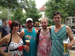 3 men and a woman all in sundresses drink beers at a previous Sundress Fest. (Photo: Wonderland Ballroom/Facebook)