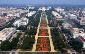 """The Monument Quilt spelling out """"You Are Not Alone"""" in English and Spanish on the National Mall. (Photo: FORCE: Upsetting Rape Culture)"""