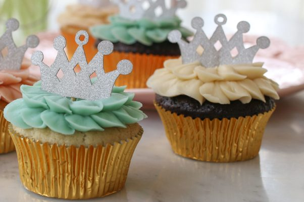 A Royal Baby cupcake decorated in blue petals and topped with a paper crown. (Photo: Magnolia Bakery)