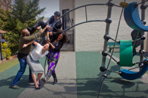 Two sets of parents fight on a playground. (Photo: Keegan Theatre)