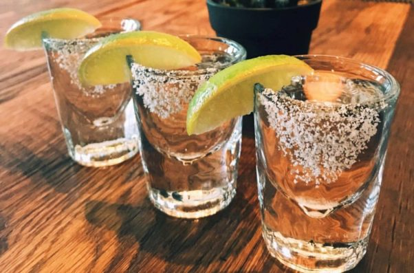 3 Mission Margaritas in glasses with salted rims and lemon wedges. (Photo: Mission)