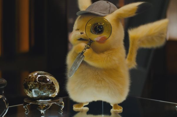 Detective Pikachu looking at a rock through a magnifying glass. (Photo: Warner Bros. Pictures)