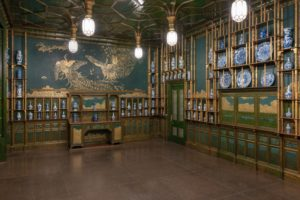 The Freer's Peacock Room with shelves along the walls filled with blue and white porcelains. (Photo: Freer Gallery of Art)