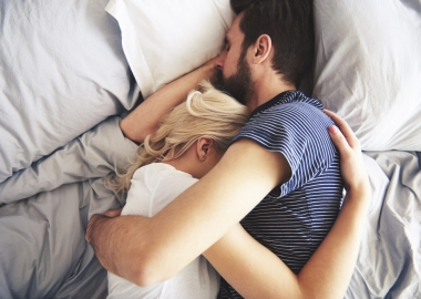White man and woman holding each other sleeping in bed. (Photo: 123rf)