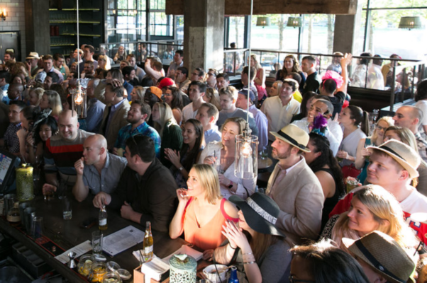 Previous year's guests watch the race in their hats at Due South. (Photo: Due South)