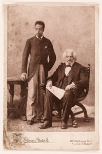 Joseph Henry Douglass stands beside a sitting Frederick Douglass in black and white photo from 1894. (Photo: Notman Photographic Co.)