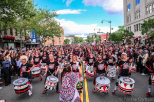 A group of female drummers all dressed alike in the Funk Parade. (Photo: Nana Gyesie)