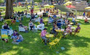 People sitting in Farragut Square on furniture using free wi-fi. (Photo: Golden Triangle BID)