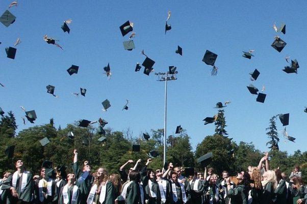 Graduates outside throwing their caps into the air. (Photo: Gillian Callison/Pixabay)