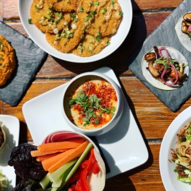 Various dishes from Jack Rose Dining Saloon's rooftop terrace menu including mushroom tacos, hummus and sliders. (Photo: Jack Rose Dining Saloon)