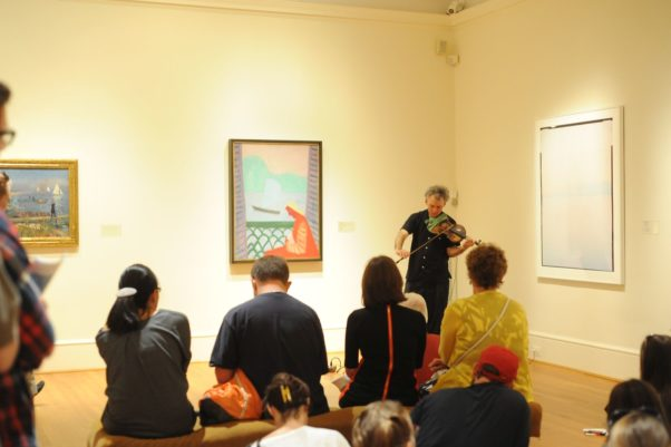 Museum visitors listening to a violinist at The Phillips Collection. (Photo: The Phillips Collection)