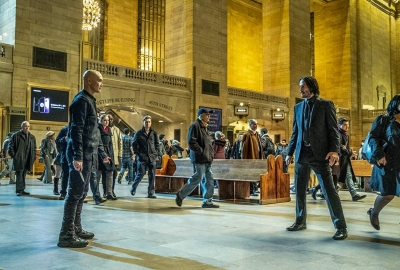John Wick (Keanu Reeves, right) and Zero (Mark Dacascos, left) prepare to fight in a busy train station. (Photo: Lionsgate Films)