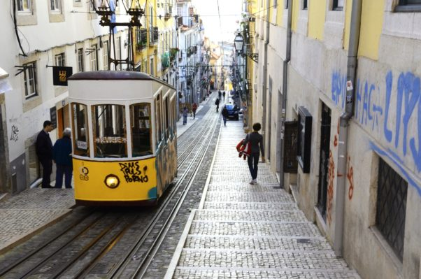 Yellow and white street car going up a steep hill in Barrio Alto. (Photo: Supplied)