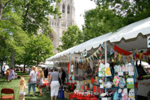 Shoppers visiting Flower Mart vendors under tents on the lawn of the National Cathedra. (Photo: All Hallows Guild)