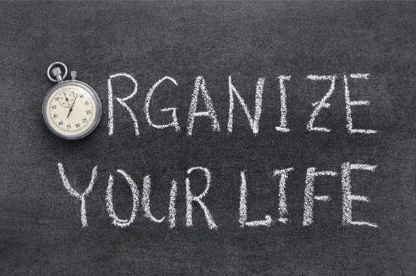 Chalkboard with ORGANIZE YOUR LIFE written on it with the first O a stop watch. (Photo: Adobe Stock)