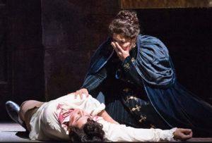 Toaca knealing over a dead body. (Photo: Kennedy Center)