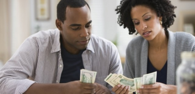 A young black couple counting money. (Photo: Getty ImagesSaving is easier if you do it together. (Photo: money.usnews.com)
