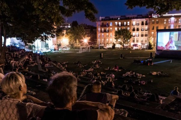 People watching a move at the Marie Reed Elementary School soccer field last year. (Photo: Adams Morgan Partnership BID)