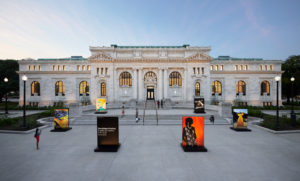 The front of the Apple store in Mount Vernon Square with artwork on the steps and park. (Photo: Apple)