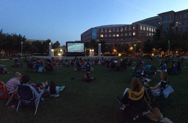 People sitting on lawn chairs watching a movie in John Carlyle Park. (Photo: Carlyle Council)