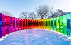 """""""Mirror, Mirror"""" is a series of 8-foot mirrors in a semi-circle with one side regular and the reservse in different colors of the rainbow. (Photo: Alan Tansey)"""