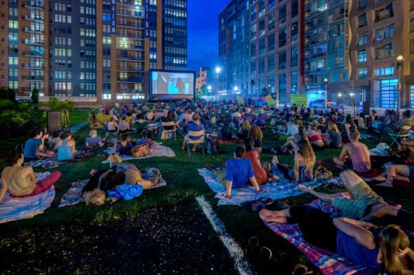 People sitting on blankets watching an outdoor movie in NoMa. (Photo: NoMa BID)